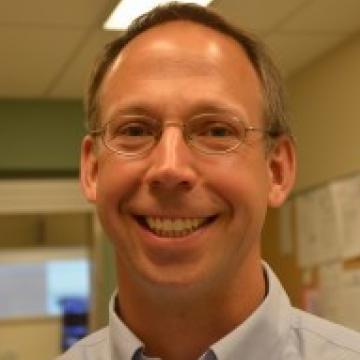 Dr. Derek Plausinis